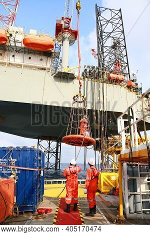 Crews Boat Moving The Passenger And Cargo From The Platform To Supply Boat In Oil And Gas Industry.
