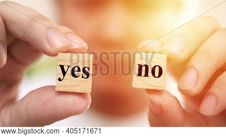 Yes Or No, Man Holding Two Wooden Cubes With Yes Or No Written On It, Making Decision Concept