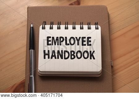 Employee Handbook, Text Words Typography Written On Book Against Wooden Background, Life And Busines