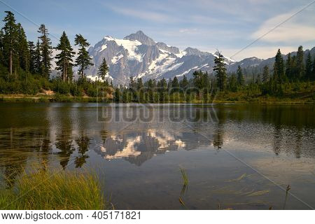 Picture Lake Mt. Baker Usa. Mt. Shuksan In The Washington State Cascade Mountain Range Reflected In