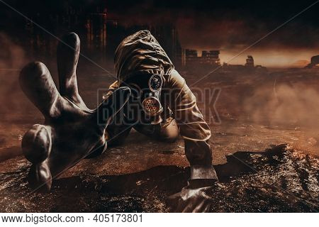 Photo Of A Dying Stalker In Jacket And Gloves In Damaged Gas Mask With Filter Reaching Out His Hand