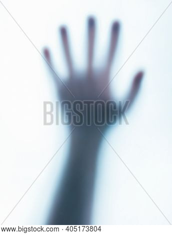Photo Of A Blurred Paranormal Human Ghost Hand On White Background.