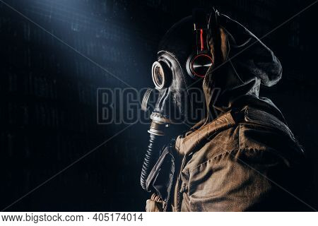 Photo Of A Stalker Soldier In Soviet Rubber Gas Mask With  Hose, Wearing Headphones And Standing Pro