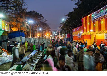 Kolkata, West Bengal, India - 12th January 2020 : Devotees Walking In The Evening At Gangasagar Tran