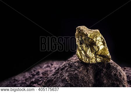Gold Nugget On Stone, Gold Inside Cave, Concept Of Rarity And Luxury