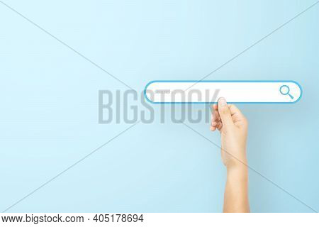 Hand Holding Paper With Search Bar On Light Blue Background. Concept Of Searching Information Data O