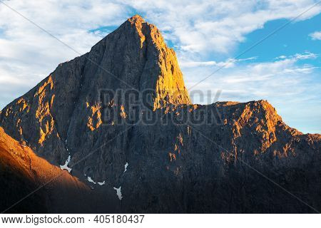 Golden Sunset Over The Wedge, A Distinctive Mountain Peak Named For Its Similarity To A Carpenter's