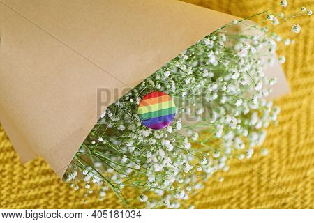 Bouquet Of White Gypsophila Flowers With The Lgbt Pride Flag Coloured In Lgbtq Pride Colours. Concep
