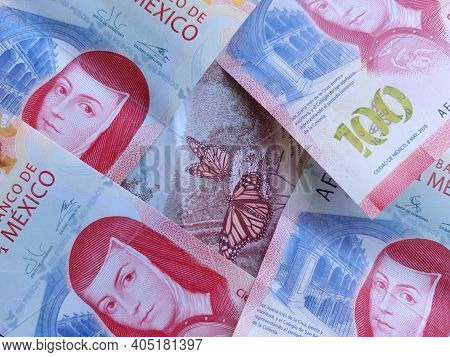Approach To Stacked Mexican Banknotes Of 100 Pesos