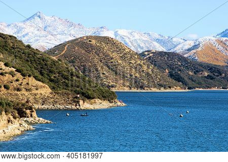 Barren Chaparral Covered Hills And Snow Capped Mountains Surrounding Silverwood Lake, Ca Taken In Th