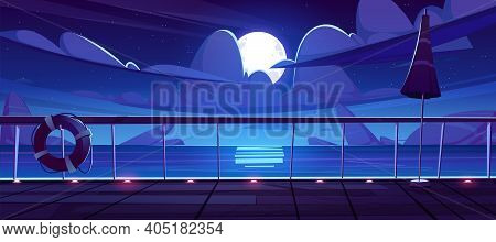 Night Seascape View From Cruise Ship Deck. Ocean Landscape With Rocks In Water, Moon And Clouds In S