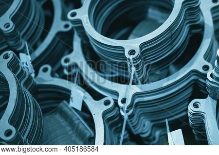 Metal Gaskets For Pipelines. Abstract Industrial Background Toned In Blue.