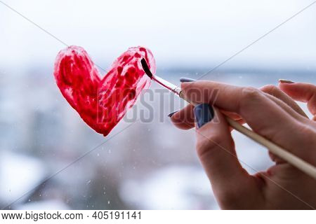 Hand Of A Girl With A Paintbrush Painting Red Heart On A Window, Stay Home, Quarantine Leisure, Let'