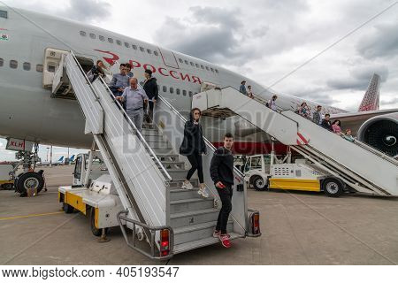 Moscow, Russia - June 6. 2018. Passengers Descend The Stairs From Plane Of The Airline Rossiya In Vn