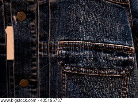 Selective Focus On Denim Jean Jacket Pocket In Clothes Shop. Denim Jacket Pocket Texture Background.