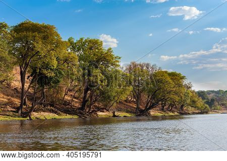 Sunset Landscape Of Of Chobe River In Botswana, View From Boat. Africa Wilderness