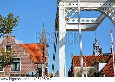 The Drawbridge Baanbrug With Historic Houses And The Spire Of The Stadhuis (town Hall) In The Backgr