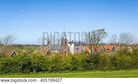 Village Oudeschild With Martinus Church And Trraditional Gable Houses On The Wadden Island Texel In