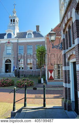 Colorful Facades Of Historic Houses In Edam, North Holland, Netherlands, With The Stadhuis (town Hal