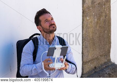 Portugal, Porto, October 06, 2018: Man Operating A Drone With Remote Control.