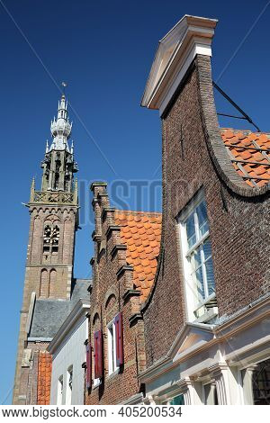 Colorful Facades Of Historic Houses In Edam, North Holland, Netherlands, With The Speeltoren (carill