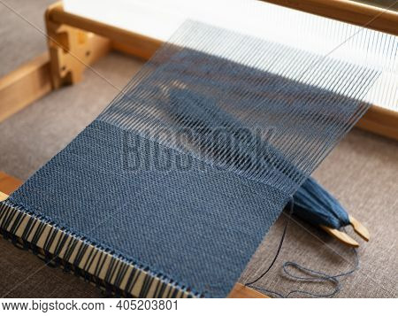 Creation Of The Textile Using A Weaving Loom