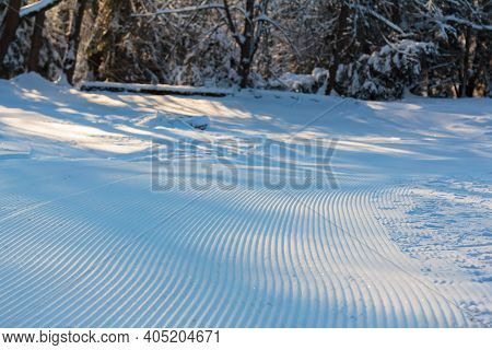 Smooth Lines On The Ski Slope, Left By A Snowcat From Flat Strips.