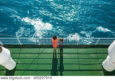 The Family Is Sailing On A Cruise Ship, A Mother With  Son Are Standing At The Fence On The Ship And