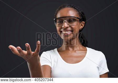 Woman wearing transparent goggles showing invisible object