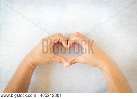 Hands Gesture Heart Shape On White Isolated Background With Copy Space. Concept For Love, Help, Kind