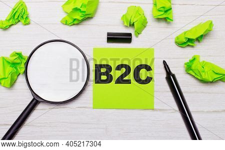 The Word B2c Business To Consumer Written On A Green Sticky Note Next To A Magnifying Glass And A Bl