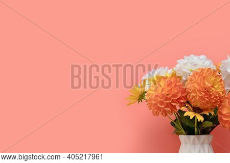 Bouquet Of Dahlia Flowers In Vase In Front Of Coral Background. Tenderness Springtime Composition Wi