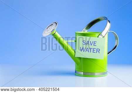 Save Water Concept. Green Watering Can With  Words Save Water Against Blue Background.