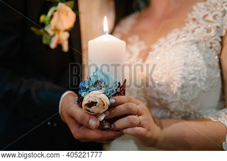 Happy Bride Hold And Groom Keep A Family Candle Burning On The Wedding Day After The Ceremony. The E
