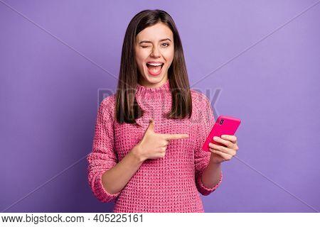Photo Portrait Of Happy Female Brunette Showing Finger Mobile Phone Winking Blinking Isolated On Viv