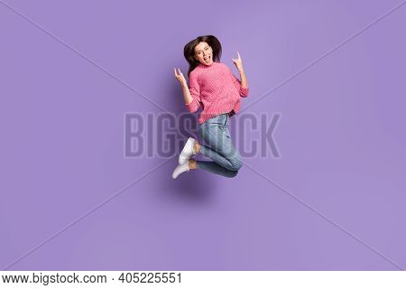 Full Length Body Size Photo Of Jumping High Female Rocker Showing Heavy Metal Gesture Isolated On Vi