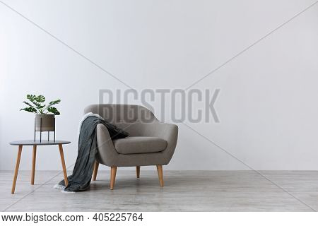 Cozy Scandinavian Design For Rest And Relaxation At Home. Gray Vintage Armchair With Plaid, Table Wi