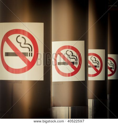 Mobile photography toned row of No Smoking signs
