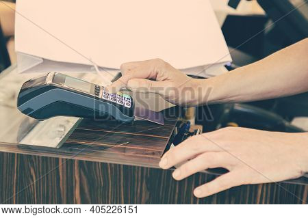 Shop Cashier Operating Payment Process With Pos Terminal And Credit Card. Cropped Shot, Closeup Of H