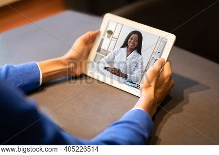Distance Medicine Concept. Unrecognizable Man Having Video Call With Black Therapist Lady While Sitt