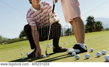 Close up shot of Golf Instructor with Student