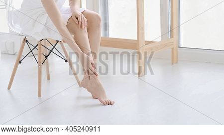 Woman Touch Her Smooth And Soft Skin On Legs, Enjoy Beauty Procedures. Young Asian Woman Applying Cr