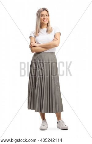 Full length portrait of a young blond woman in a pleated skirt isolated on white background