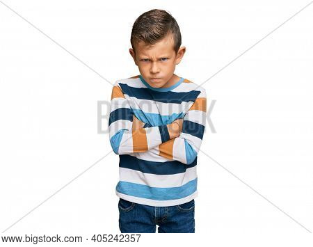 Adorable caucasian kid wearing casual clothes skeptic and nervous, disapproving expression on face with crossed arms. negative person.
