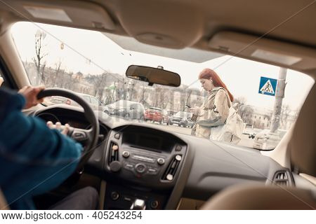 Distracted Teenage Girl Texting, Using Her Mobile Phone While Crossing The Street. Male Driver Honki