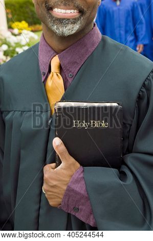 Portrait of pastor holding the bible