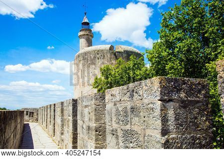 Antique walls of the medieval port city of Aigues-Mortes. The historic tower of Constance. Mediterranean coast of France. The concept of active, historical and photo tourism