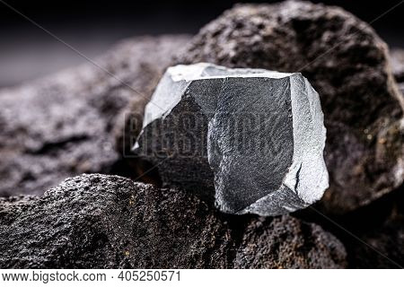 Iron Ore On A Rocky Base. Ore Found In Mineral Extraction Mine