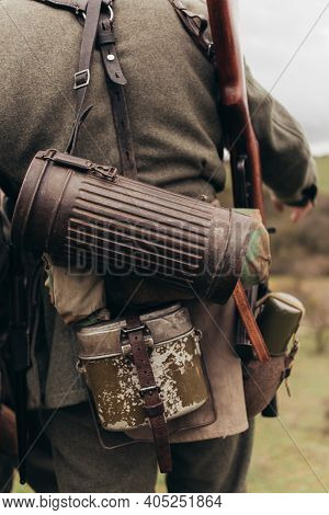A Man In A Soldiers Uniform With A Flask And A Tube During The Reconstruction Of Hostilities