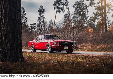 Kyiv, Ukraine - November 2019. Powerful Classic American Muscle Car Ford Mustang 1967 In A Red Color